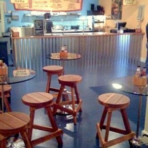 "Backless Bar Stools (Options: 19"", 24"", 29"" and 36"" H, M Redwood, Round 15"" Diameter Seat, 3 Legs, No Engraving, Transparent Premium Sealant). Photo Courtesy of Bebop Burrito of Warren, Rhode Island."
