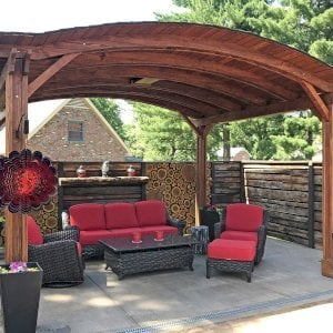 Backyard Pavilion (Options: 12' L x 14' Arc W, California Redwood, 2 Post Electrical Wiring Trim, 4 Post Anchor Kit for Stone, Add Ceiling Fan Base, No Privacy Panels, No Curtain Rods, 9 ft Post Height, Coffee-Stain Premium Sealant). Photo Courtesy of Jacques & Kristi.
