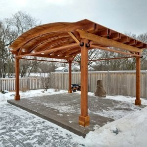 Backyard Pavilion (Options: 15' L x 18' Arc W, California Redwood, 2 Post Electrical Wiring Trims, 4 Post Anchor Kit for Concrete, 1 Ceiling Fan Base, No Privacy Panels, 4 Curtain Rods, 9 ft Post Height, Transparent Premium Sealant). Photo Courtesy of M. McDonald of Lake Barrington, Illinois.