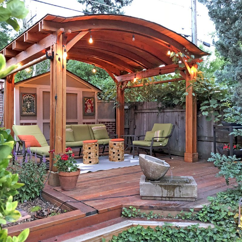 Backyard Pavilion (Options: 10' L x 12' Arc W, Douglas-fir, 2 Post Electrical Wiring Trim, 4 Post Anchor Kit for Wood, No Ceiling Fan Base, No Privacy Panels, 2 Curtain Rods, 9 ft Post Height, Transparent Premium Sealant). Photo Courtesy of Paul Upsons of Denver, Colorado.