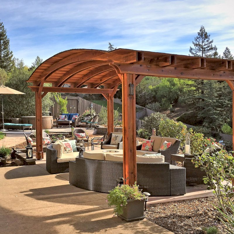 Backyard Pavilion (Options: 12' L x 22' Arc W, California Redwood, No Electrical Wiring Trim, 4 Post Anchor Kit for Gale-Wind, No Ceiling Fan Base, No Privacy Panels, No Curtain Rods, 9.5 ft Post Height, Transparent Premium Sealant). Photo Courtesy of S. Bell of Santa Rosa, CA.