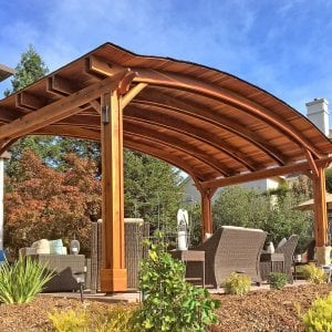 Backyard Pavilion (Options: 12' L x 22' Arc W, Redwood, No Electrical Wiring Trim, 4 Post Anchor Kit for Gale-Wind, No Ceiling Fan Base, No Privacy Panels, No Curtain Rods, 9.5 ft Post Height, Transparent Premium Sealant). Photo Courtesy of S. Bell of Santa Rosa, CA.