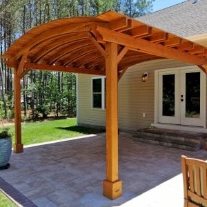 Backyard Pavilion (Options: 16' L x 15' Arc W, Douglas-fir, No Post Electrical Wiring Trim, 4 Post Anchor Kit for Concrete, No Ceiling Fan Base, No Privacy Panels, No Curtain Rods, 9 ft Post Height, Transparent Premium Sealant). Photo Courtesy of S. Fly of Millsboro, Delaware.