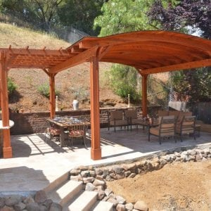 Custom Backyard Pavilion (Options: 18' x 18', with 9' x 14' Garden Pergola Attached, Redwood, 1 Electrical Wiring Trim Kit, 6 Post Anchor Kit for Gale-Wind, 2 Ceiling Fan Bases, No Privacy Panels, No Curtain Rods, 10 ft Post Height, Transparent Premium Sealant). Photo Courtesy of J. Angwin of Morgan Hill, CA.