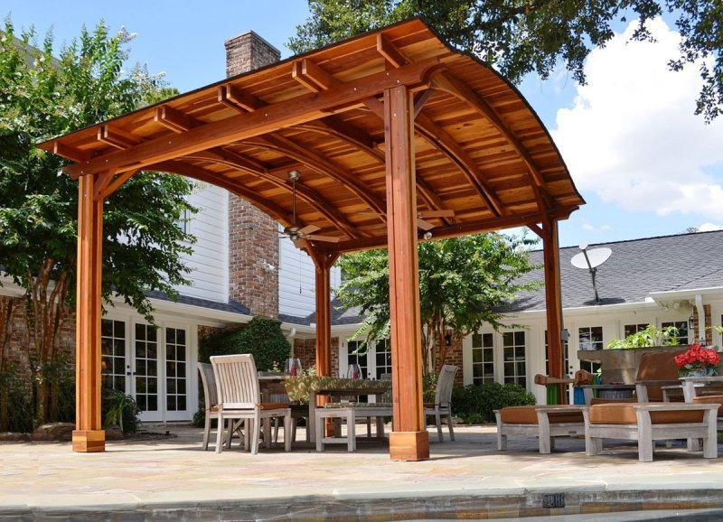 Backyard Pavilion (Options: 14' L x 16' Arc W, California Redwood, 1 Post Electrical Wiring Trim, 4 Post Anchor Kit for Concrete, Add 2 Ceiling Fan Bases, No Privacy Panels, No Curtain Rods, 10 ft Post Height, Transparent Premium Sealant). Photo Courtesy of John E. Ligums of Houston, Texas.