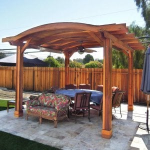 Backyard Pavilion (Options: 14' L x 16' Arc W, Redwood, 2 Post Electrical Wiring Trim, 4 Post Anchor Kit for Stone, Add Ceiling Fan Base, No Privacy Panels, No Curtain Rods, 9 ft Post Height, Transparent Premium Sealant).