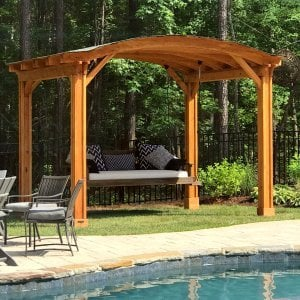 Backyard Pavilion (Options: 12' L x 10' Arc W, Douglas-fir, No Electrical Wiring Trim, 4 Post Anchor Kit for Gale-Wind, No Ceiling Fan Base, No Privacy Panels, No Curtain Rods, 9 ft Post Height, Transparent Premium Sealant). Swing added by customer. Photo Courtesy of E. Schechtman of Wake Forest, NC.