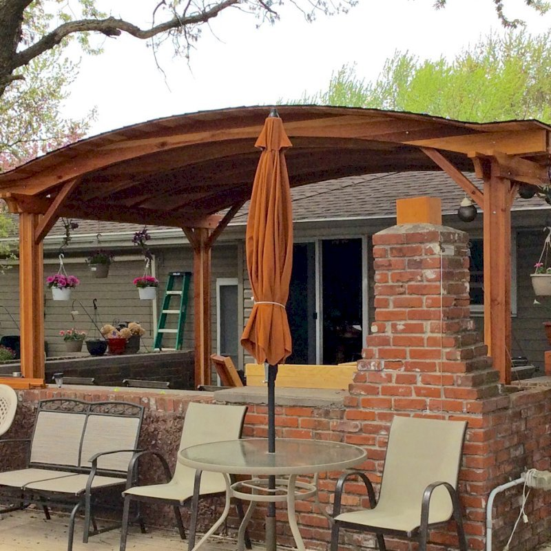 Backyard Pavilion (Options: 20' x 12', California Redwood, No Electrical Wiring Trim Kit, 4 Post Anchor Kit for Stone, No Ceiling Fan Base, No Privacy Panels, No Curtain Rods, 10 ft Post Height, Transparent Premium Sealant). Photo Courtesy of Gary C. of Blaine, Minnesota.