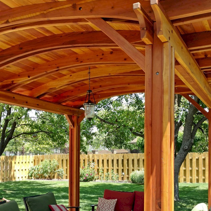 Backyard Pavilion (Options: 14' L x 12' Arc W, California Redwood, No Electrical Wiring Trim, 4 Post Anchor Kit for Concrete, No Ceiling Fan Base, No Privacy Panels, No Curtain Rods, 9 ft Post Height, Transparent Premium Sealant). Photo Courtesy of B. Hardesty of Great Bend, KS.