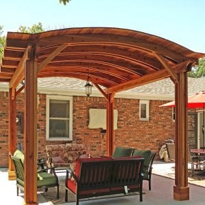 Backyard Pavilion (Options: 14' L x 12' Arc W, Redwood, No Electrical Wiring Trim, 4 Post Anchor Kit for Concrete, No Ceiling Fan Base, No Privacy Panels, No Curtain Rods, 9 ft Post Height, Transparent Premium Sealant). Photo Courtesy of B. Hardesty of Great Bend, KS.