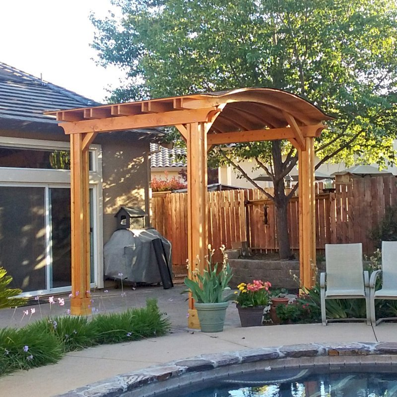 Backyard Pavilion (Options: 12' L x 10' Arc W, Douglas-fir, 1 Post Electrical Wiring Trim, 4 Post Anchor Kit for Concrete, Add Ceiling Fan Base, No Privacy Panels, No Curtain Rods, 9 ft Post Height, Transparent Premium Sealant). Photo Courtesy of R. Short of Roseville, CA.