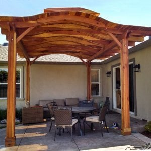 Backyard Pavilion (Options: 18' x 15', Redwood, No Electrical Wiring Trim, 4 Post Anchor Kit for Stone, No Ceiling Fan Base, No Privacy Panels, No Curtain Rods, 9.5 ft Post Height, Transparent Premium Sealant). Note: Skylights are custom add-on we can do for any size Pavilion roof. Overhang is longer on one side than other by custom request (standard overhang is 12