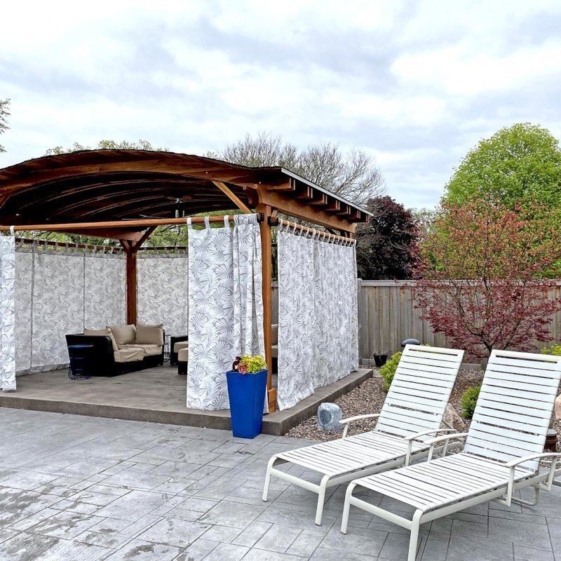 Backyard Pavilion (Options: 15' L x 18' Arc W, California Redwood, 2 Post Electrical Wiring Trims, 4 Post Anchor Kit for Concrete, 1 Ceiling Fan Base, No Privacy Panels, 4 Curtain Rods, 9 ft Post Height, Transparent Premium Sealant). Photo Courtesy of S. McDonald of Lake Barrington, Illinois.