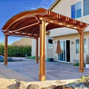 Backyard Pavilion (Options: 14' L x 22' Arc W, Redwood, 1 Post Electrical Wiring Trim, 4 Post Anchor Kit for Concrete, With 2 Ceiling Fan Bases, No Privacy Panels, 2 Curtain Rods, 9.5 ft Post Height, Transparent Premium Sealant). Photo Courtesy of T. Bauer of Sacramento, CA.