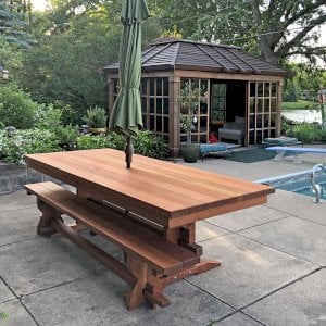 """Baja Table (Options: 8 ft L, 42 inches W, Side Benches [Only 1 Shown in Photo], California Redwood, Standard Tabletop [with Lengthwise Boards by Custom Request], Squared Corners, 2"""" Umbrella Hole, Transparent Premium Sealant). Dream Gazebo Shown in Background. Photo Courtesy of D. Womack of White Bear Lake, Minnesota."""