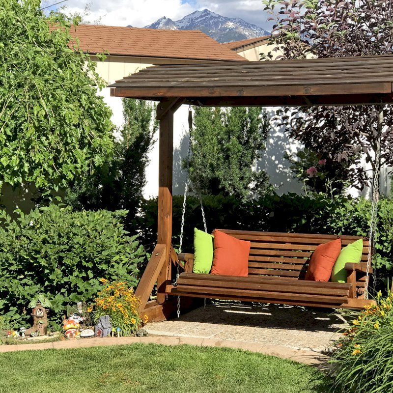 Bench Swing Set (Options: Large Bench, Include Swing Roof, Old-Growth Redwood, Ensenada Style Seat, No Engraving, Transparent Premium Sealant). Photo Courtesy of Ann Harrington of Salt Lake City, Utah.