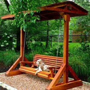 Bench Swing Set (Options: Large Bench, Include Swing Roof, Mature Redwood, Ensenada Style Seat, No Engraving, Transparent Premium Sealant). Photo courtesy of The Krifcher Family and Jojo, Potomac, MD.