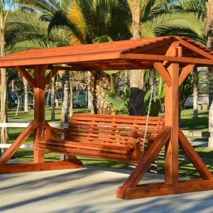"Custom Bench Swing Set (Options: Custom Bench Size, Include Swing Roof, Redwood, Ensenada Style Seat, No Engraving, Transparent Premium Sealant). Thicker design by custom request. Roof size is 12' x 7', bench is 9' total length, with 5 1/2"" x 5 1/2"" posts."