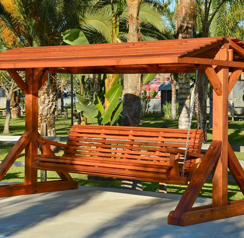 """Custom Bench Swing Set (Options: Custom Bench Size, Include Swing Roof, California Redwood, Ensenada Style Seat, No Engraving, Transparent Premium Sealant). Thicker design by custom request. Roof size is 12' x 7', bench is 9' total length, with 5 1/2"""" x 5 1/2"""" posts."""