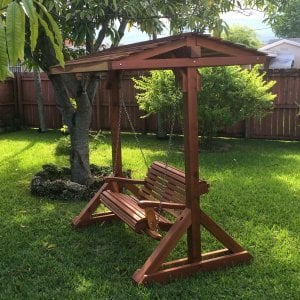 Bench Swing Set (Options: Standard Bench, Include Swing Roof, Redwood, Ensenada Style Seat, No Engraving, Transparent Premium Sealant).  Photo Courtesy of Ms. Norma Figueiras of Miami, FL.