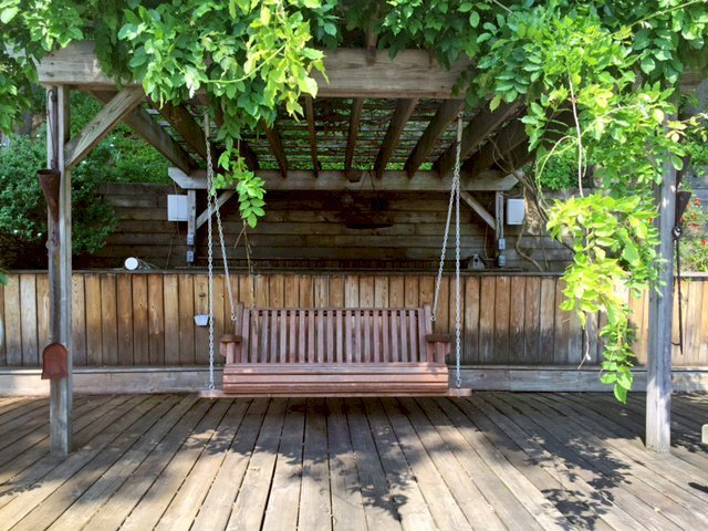 Bench Swing (Options: Large Garden Bench, California Redwood, Classic Seat Design, No Engraving, All Beam Hanging Hardware, Unfinished). Photo Courtesy of D. Lynch of Cary, NC.