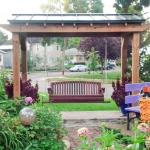 Bench Swing (Options: Large Garden Bench, Old-Growth Redwood, Luna Backrest Seat, No Engraving, All Beam Hanging Hardware, Cherry Stain Premium Sealant). Photo Courtesy of Robert MacDonald of Minneapolis, Minnesota. Pergola is a custom job made in Douglas-fir.