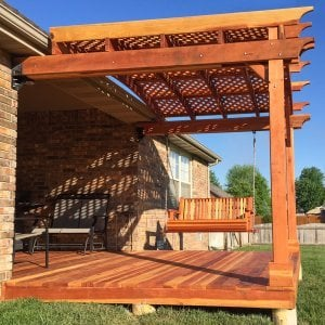 Bench Swing (Options: Standard Garden Bench, California Redwood, Classic Seat Design, No Engraving, All Beam Hanging Hardware, Transparent Premium Sealant). Photo also shows a custom deck and an attached garden pergola. Photo courtesy of Telory A. of Springfield, MO.