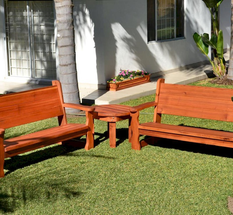 """Carmel Box Planter in Background (Options: 60"""" L, 10.5"""" W, 7.5"""" H, California Redwood, Standard Base, No Steel Hangers, No fit over railings, No Growing Vegetables, Transparent Premium Sealant). In front of planter are 2 Angel Benches with a Round Side Table."""