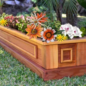 "Carmel Box Planter (Options: 60"" L, 10.5"" W, 7.5"" H, Redwood, Standard Base, No Steel Hangers, No fit over railings, No Growing Vegetables, Transparent Premium Sealant). Yes, the flowers are made of silk, but they looked so pretty we had to include them!"