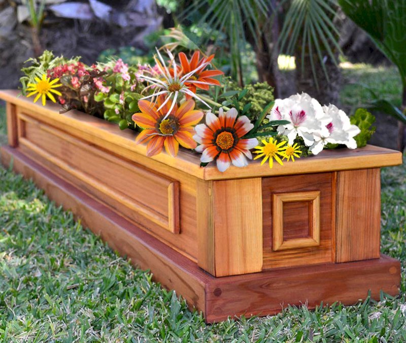 """Carmel Box Planter (Options: 60"""" L, 10.5"""" W, 7.5"""" H, California Redwood, Standard Base, No Steel Hangers, No fit over railings, No Growing Vegetables, Transparent Premium Sealant). Yes, the flowers are made of silk, but they looked so pretty we had to include them!"""
