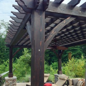 Cherry Hill Pergola (Options: 20' x 14', Redwood, Electrical Wiring Trim for 1 Post, Post Anchoring for Stone, Brick or Concrete, Ceiling Fan Base, No Curtain Rods, No Privacy Panels, 8.5' Post, Coffee-Stain Premium Sealant). 2 x 8 Roof Timbers and 8 x 8 Posts by Custom Request. Cost to build any Pergola with bigger timbers is 25% more than the standard sized. Photo courtesy of William H. of Montvale, NJ.