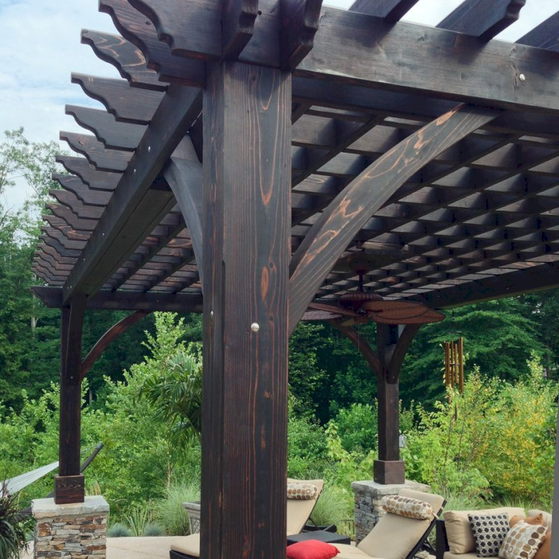 Cherry Hill Pergola (Options: 20' x 14', California Redwood, Electrical Wiring Trim for 1 Post, Post Anchoring for Stone, Brick or Concrete, Ceiling Fan Base, No Curtain Rods, No Privacy Panels, 8.5' Post, Coffee-Stain Premium Sealant). 2 x 8 Roof Timbers and 8 x 8 Posts by Custom Request. Cost to build any Pergola with bigger timbers is 25% more than the standard sized. Photo courtesy of William H. of Montvale, NJ.