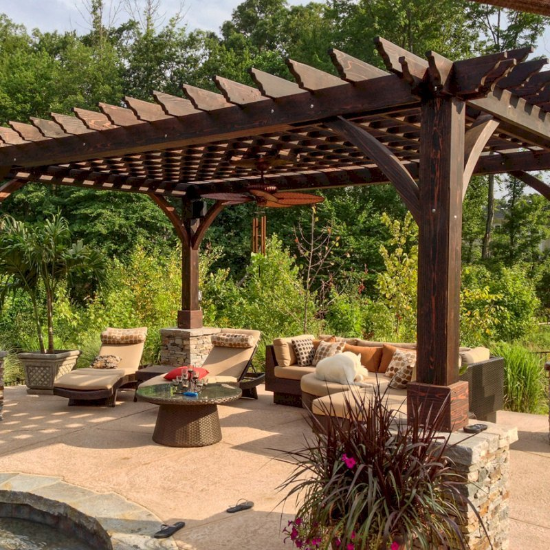 """Cherry Hill Pergola (Options: 20' x 14', California Redwood, Electrical Wiring Trim for 1 Post, Slats at 12"""", Rafters at 18"""", Post Anchoring for Stone, Brick or Concrete, Ceiling Fan Base, No Privacy Panels, 8.5' Post, Coffee-Stain Premium Sealant). 2 x 8 Roof Timbers and 8 x 8 Posts by Custom Request. Cost to build any Pergola with bigger timbers is 25% more than the standard sized. Photo courtesy of William H. of Montvale, NJ."""