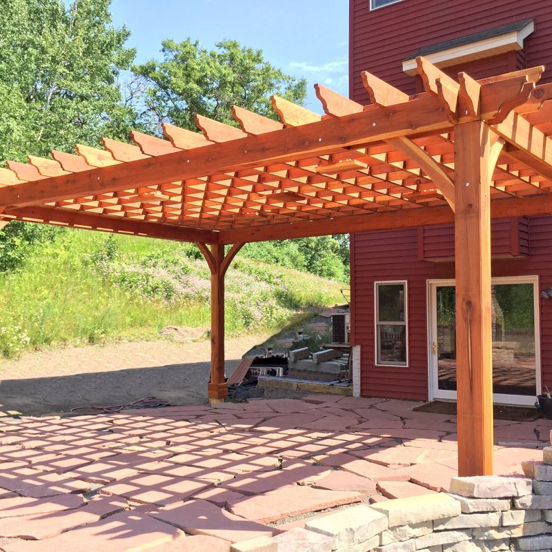 Cherry Hill Pergola (Options: 18' x 24', California Redwood, Post Anchoring for Gale-Wind, 5 Ceiling Fan Bases, No Curtain Rods, No Privacy Panels, 10.5' Post, Transparent Premium Sealant). 2 x 10 Supports, 2 x 8 Rafters and 8 x 8 Posts by Custom Request. Photo Courtesy of M. Lockheart of Hudson, WI.