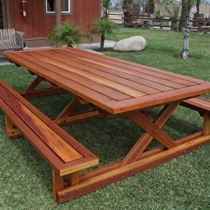 "Chris's Picnic Table (Options: 10' L x 46"" W, Redwood, Standard Tabletop, Rounded Corners, No Umbrella Hole, Transparent Premium Sealant)."