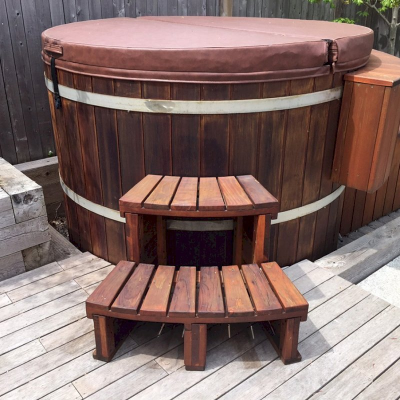 Circular Spa Step (Options: Angle to Fit Snugly for 6' Tub, California Redwood, No Engraving, Transparent Premium Sealant). Photo Courtesy of Brian L. of Provincetown, Massachusetts.