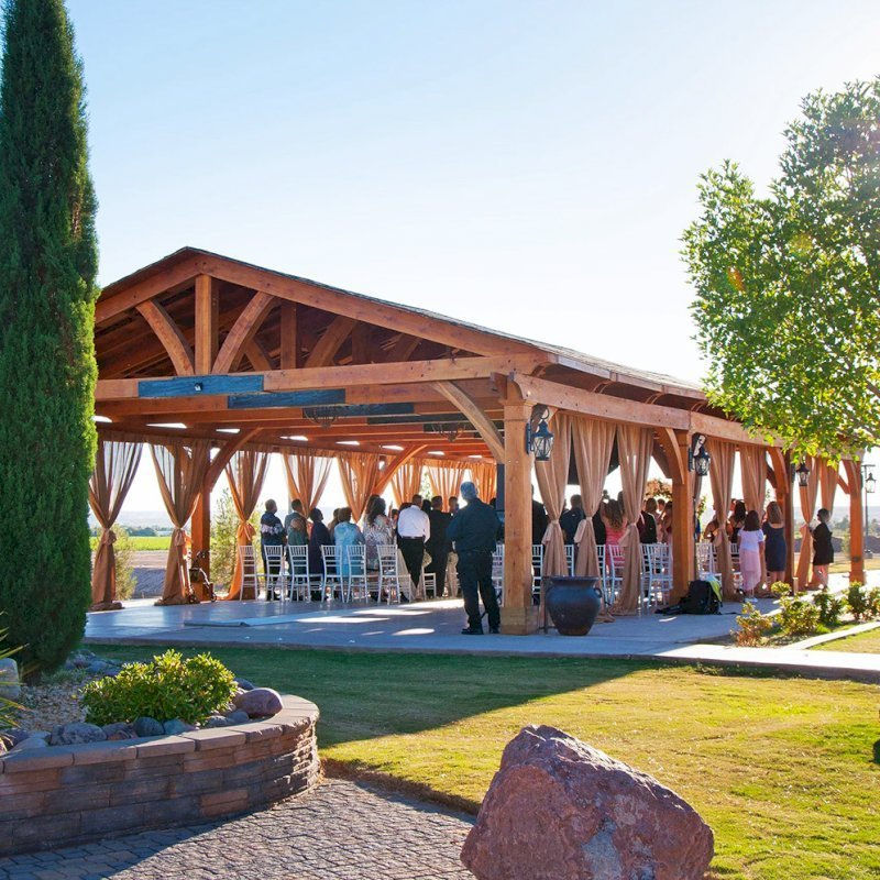 Custom Fat Timber Wood Pavilion Kits (Options: 30' x 60', Mature Redwood, 8-Post Anchor Kit for Gale-Wind, Transparent Premium Sealant). Photo Courtesy of Mr. & Ms. Rodriguez of El Paso Grace Gardens, 6701 Westside Dr. El Paso, Texas, 79932. We can build your Pavilion any size you need.