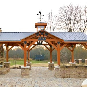 Custom Wood Pavilion Kits (Options: 30' L x 15' W, Douglas-fir, No Electrical Wiring Trim Kit, Gale-Wind Anchors, Transparent Premium Sealant). Photo Courtesy of C. O'Connell of Farmington Hills, Michigan.