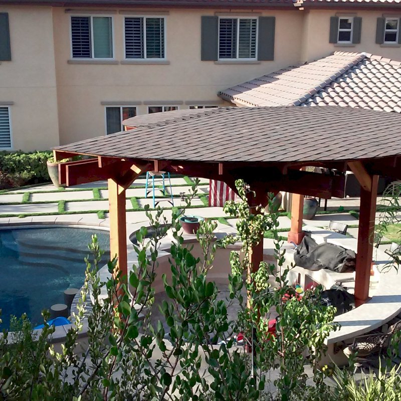 """Custom Wood Pavilion Kits (Options: 24' Diameter. Post 9'-3/4"""", Arch Supports, 6 Grades Slope Roof, California  Redwood, Unattached, Electrical Wiring Trim for 1 Post, 6-post kit for stone, brick, or concrete (with anchor bolts), No Ceiling Fan Base, No Privacy Panels, No Curtain Rods, 10' Post Height, Transparent Premium Sealant)"""