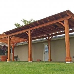 Custom Wood Pavilion Kits (Options: 24' L x 12' W, Redwood, One Ceiling Fan Base, Electrical Wiring Trim Kit for 1 Post, Gale-Wind Anchors for 8 Posts, 8 x 8 Posts by Custom Request, Transparent Premium Sealant) with a 14' L x 12' W Garde Pergola Attached. Photo Courtesy of G. Scotzin of Pasco, WA.