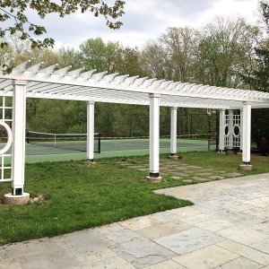 Custom Wooden Fat Timber Pergola (Options: 40' x 18', Redwood, Posts Anchor Kit for Gale-Wind, Custom Trellis Between Corner Posts, Off-White Oil-Based Primer). Photo Courtesy of L. Hascoe of Greenwich, CT. Custom copper caps atop all posts.