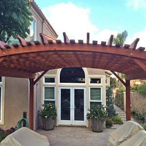 Custom Wooden Fat Timber Pergola (Options: 14' L, 14' W, Mature Redwood, 2 Electrical Wiring Trims, Open Roof with Extra Slats by Custom Request, Lengthwise Roof Support Timbers, 4 Post Anchor Kit for Stone, No Privacy Panels, No Curtain Rods, 9ft Post Height, Transparent Premium Sealant ). Photo Courtesy of J. Cheetham of Laguna Niguel, CA..