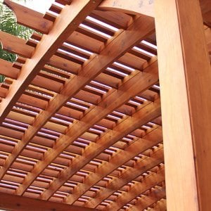Custom Wooden Fat Timber Pergola (Options: 26' x 24', Mature Redwood, Unattached, Open Roof with Extra Slats by Custom Request, Transparent Premium Sealant). Photo Courtesy of Ms. Diane Williams of Encinitas, CA. Photo shows extra large timber custom design with 8x8 posts and 2x10 arches, 26 ft long.