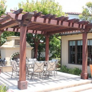 """Custom Wooden Fat Timber Pergola (Options: 15' L x 15' W, Old Growth Redwood, Include Wiring Trim for 1 Post, Open Roof with Slats at 18"""" Rafters at 18"""" Roof Support Timbers, No Anchor Kit, No Ceiling Fan Base, No Privacy Panels, No Curtain Rods, 11ft 6in Post Height square to outside corners, Include enough overhang to go to full 15 ft square roof size., Coffee-Stain Premium Sealant). Photo Courtesy of Bruce K. of Newport Coast, CA."""