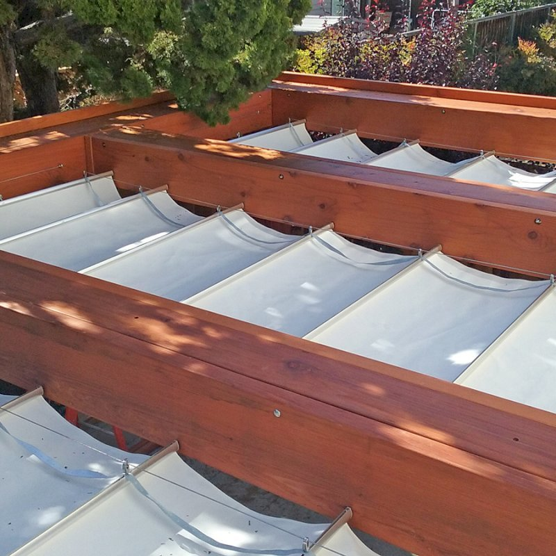 """Custom Wooden Fat Timber Pergola (Options: 20' L, 16' W, Old-Growth Redwood, 4 Electrical Wiring Trims, with 2 3/4"""" x 11 1/4"""" Roof Timbers and 11 1/4"""" x 11 1/4"""" Posts, 4 Post Anchor Kit for Hurricane, No Privacy Panels, Curtain Rods on 4 sides, 10' Post Height, Transparent Premium Sealant). Retractable Canopy designed in cooperation with Infinity Canopy of Los Angeles, CA (www.infinitycanopy.com). Once you have your design finalized, you can forward your drawings to Infinity to add the perfect retractable canopy solution for maximum shade versatility! Photo Courtesy of Darren & Elva Linscott of San Jose, CA."""