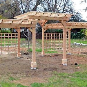 Custom Pergola (Options: 26' x 14', Douglas-fir, Posts Anchor Kit for Concrete, Custom Sealant, 2 Level Garden Pergola Design with Rear Trellis).  Unfinished Photo Just After Installation, Customer to Custom Paint. Photo Courtesy of D. Inversin of Loomis, California.