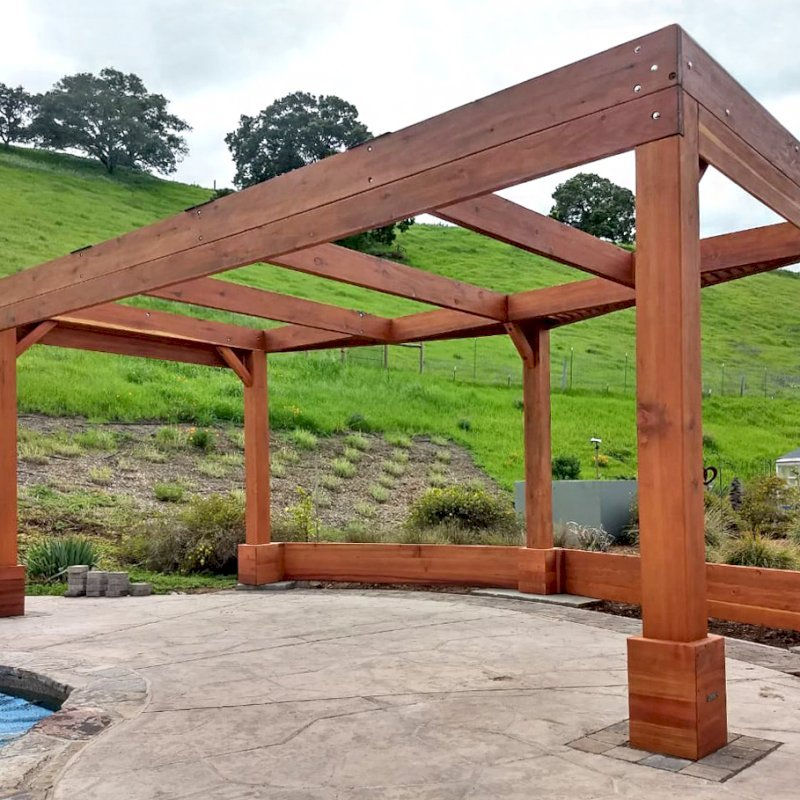Custom Pergolas (Options: 20' x 12', Mature Redwood, Posts Anchor Kit for Hurricane, Transparent Premium Sealant). Photo Courtesy of D. Ruprecht of Hollister, CA.