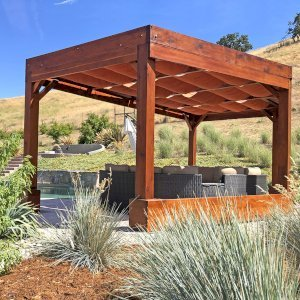 Custom Pergolas (Options: 20' x 12', Mature Redwood, Posts Anchor Kit for Hurricane, Transparent Premium Sealant). Retractable Shade Canopies Installed by Customer. Photo Courtesy of D. Ruprecht of Hollister, CA.