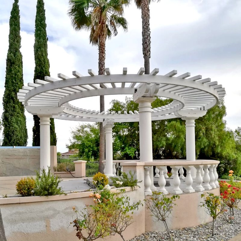 "Custom Pergolas (Options: 20'-6"" Diameter, Mature Redwood, Placed Atop Load Bearing Columns, White Primer). Photo Courtesy of K. Pathak of Fremont, California."