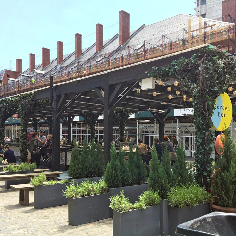 "Custom Wooden Pergola (Options: 82' L x 16' W, Douglas-fir, Open Roof with Rafters at 18"", with Transparent Rain Guard, 12-Post Anchor Kit, No Ceiling Fan Base, 12' Post Height, Custom Black Paint). This pergola is part of the giant popup beer hall at the Southside Seaport in downtown Manhattan from May to Oct 2017: https://www.timeout.com/newyork/blog/a-giant-pop-up-beer-hall-is-opening-at-south-street-seaport-this-summer-032417"